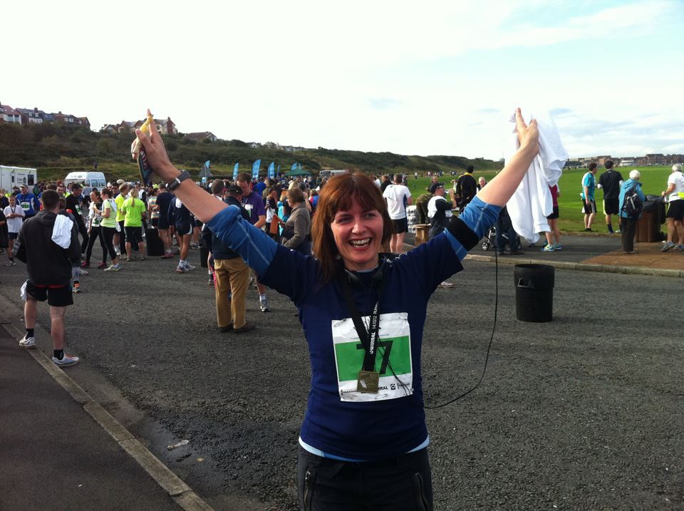 Glenda Cooper in training for the Liverpool half marathon, celebrating crosssing the finnish line